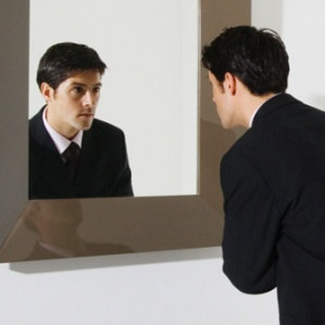 businessman-looking-in-mirror-bkt_12170